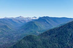 Mountain view on mountains from top pick with clear sky. Royalty Free Stock Photos