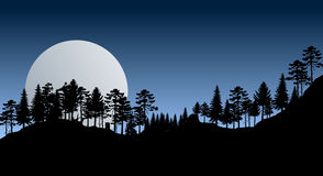 Mountain view by night with trees Royalty Free Stock Photography