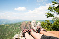 Mountain view over women legs as she rests on mountain peak.  Royalty Free Stock Photos