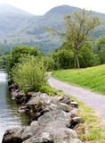 Mountain view. Path in the park. Cloudy day. Path at the lake Stock Photos