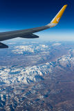 Mountain view from plane wing Royalty Free Stock Images