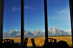 Mountain view from a restaurant. View of Grand Teton Mountains from a dining table Royalty Free Stock Photography