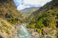 Mountain view with a river as a foreground in Nepal Royalty Free Stock Photos