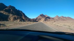 Mountain view at Saint Catherine. In car, Sinai Peninsula, Egypt. Clear after noon sky in the winter stock image