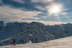 Mountain view with skier in front stock images