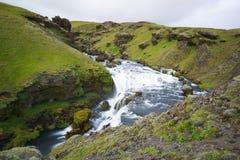 Mountain view of Skogarfoss waterfall, Iceland. Royalty Free Stock Image