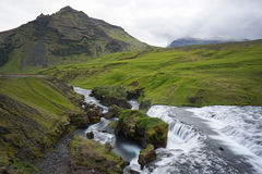Mountain view of Skogarfoss waterfall, Iceland. Royalty Free Stock Photos
