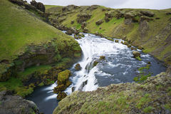 Mountain view of Skogarfoss waterfall, Iceland. Royalty Free Stock Images