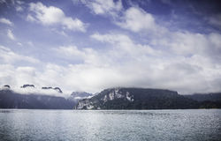 Mountain view with sky, cloud, fog and water surface. At chiewlarn dam or ratchaprapa dam, Suratthani, Thailand Stock Photography