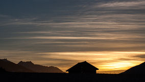 Mountain view with soft light and a barn. Royalty Free Stock Image