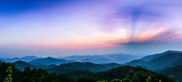 Mountain view with sunray. Morning view with sunray in national park with foggy environment royalty free stock image