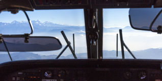 Mountain View throw front window of pilots cabin. Of small passenger and utility aircraft serving local connection in Nepal Royalty Free Stock Images