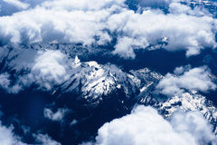 Mountain view from the top through the clouds Stock Photography