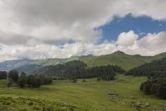 Mountain view. Mountain valley view. Cloudy sky Stock Photos