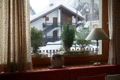 Mountain view from the window in house in Alpes, Italy Lamp and decorative old vintage kettle.  Stock Photos
