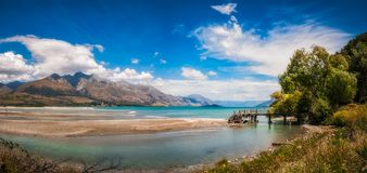 Unspoiled alpine scenery in Kinloch, New Zealand. Mountain View and wooden piers at Kinloch, an unspoiled and remote touristic site located where Dart river is stock photos