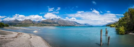 Alpine scenery panorama at Kinloch, New Zealand. Mountain View and wooden piers at Kinloch, an unspoiled and remote touristic site located where Dart river is Royalty Free Stock Photo