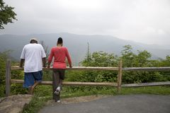 Mountain views. Couple looking at mountain views, many travelers go to the mountains to enjoy the peace & serenity of nature stock photography