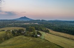 Mountain Views. Pilot Mountain North Carolina farmland Just before sunrise Stock Photos