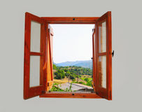 Mountain views from the window. Mountain views from the open window of the light room Royalty Free Stock Image