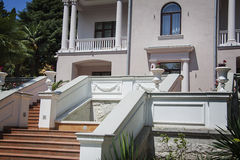 Mountain villa. Beautiful villa in ancient greek classic style with landscaped green territory; outdoor panorama with copy space royalty free stock images