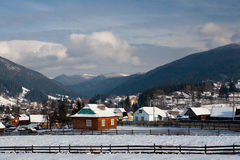 Mountain village. Beautiful winter sunny day in the mountains (Carpathians Stock Image