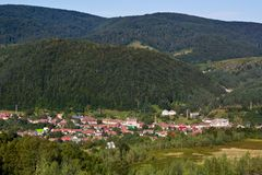 Mountain village. Part of the Valiug village and mountain scenery which surround it, from Caras-Severin county,Romania Royalty Free Stock Photo
