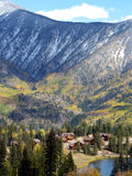 Mountain Village. Cluster of homes nestled in the Rocky Mountains during Autumn stock photos