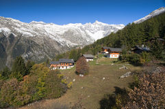 Mountain village. Small village on hill with mountains in background. Location is Bellwald Switzerland Stock Images