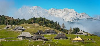 Mountain village in Alps. Wooden houses in traditional style, Velika Planina, Kamnik, Slovenia Royalty Free Stock Photo