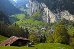 Mountain village in the Alps, Switzerland . Beautiful traditional mountain village and waterfalls in the Alps, Switzerland Royalty Free Stock Photos