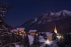 Mountain village in the austrian alps at night stock photography