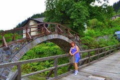 Mountain village bridge woman Stock Photography