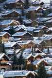 Mountain village chalets. View of verbier in the swiss alps on perfect crisp winters day, perspective compression from extreme telephoto lens stock photos