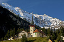 Mountain village with church Stock Images