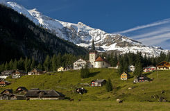 Mountain village with church Royalty Free Stock Photo