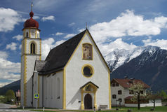 Mountain village church in Tirol Stock Photos