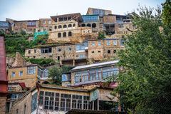 Mountain village. A mountain village in Dagestan. Houses in the mountains, multi-colored roof Stock Photography