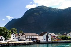 Mountain Village in a Fjord Stock Photo