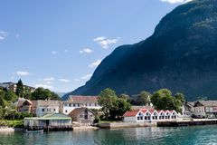 Mountain Village in a Fjord Stock Image