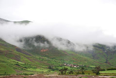 Mountain village in fog Stock Image