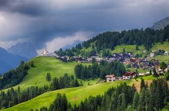 Mountain village with house in Dolomites stock photo