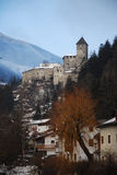 Mountain village in Italy. Quaint mountain village with abbey visible in mountainous setting, Italy stock photo