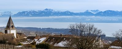 Mountain village by lake geneva with swiss alps royalty free stock photos