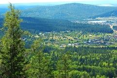 Mountain village landscape. Mountain village in Ural valley Royalty Free Stock Photo