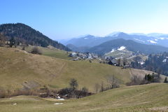 Mountain village landscape. Mountainous village landscape at the end of the winter - beginning of spring. Location: Sorica in Slovenia, Europe royalty free stock photos