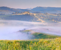 Mountain village in the mist Royalty Free Stock Photos