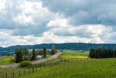 Mountain village. Mountain road. Mountain meadow. Rural landscape. Carpathians, Ukraine. Royalty Free Stock Image
