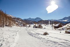Mountain village nestled in the snow. On a sunny day in winter Royalty Free Stock Images