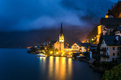 Mountain Village at Night and Reflection in Water. Night View of Hallstatt, a Lakeside Village in the Austrian Alps Stock Image